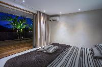 cool bedroom with terrace at Saint Barth Villa Apache luxury holiday home, vacation rental