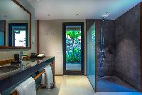 cool bathroom with rain shower in Saint Barth Villa Apache luxury holiday home, vacation rental