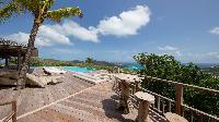 awesome poolside deck of Saint Barth Villa Ixfalia luxury holiday home, vacation rental