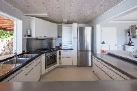 cool modern kitchen of Saint Barth Villa Mapou luxury holiday home, vacation rental