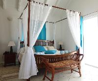 cool canopy bed in Saint Barth Villa Aquamarine luxury vacation rental