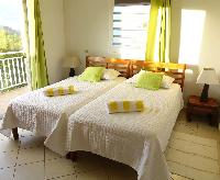 crisp bedroom linens in Saint Barth Villa Aquamarine luxury vacation rental