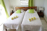 clean bedroom linens in Saint Barth Villa Aquamarine luxury vacation rental