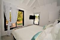 pristine bed sheets and pillows in Saint Barth Luxury Villa Amancaya Estate vacation rental