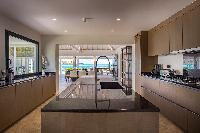 cool kitchen island in Saint Barth Villa Aqua luxury holiday home, vacation rental