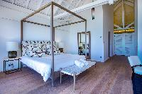 cool four-poster bed in Saint Barth Villa Bleu luxury holiday home, vacation rental