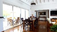 cool dining room of Saint Barth Villa Petit Paradis luxury holiday home, vacation rental