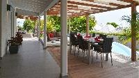 cool poolside patio of Saint Barth Luxury Villa Evan holiday home, vacation rental