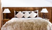 pristine bedroom linens in Chalet Grand Sapin luxury apartment, holiday home, vacation rental
