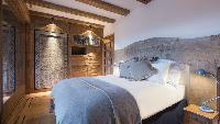 fresh bedroom linens in Chalet Orsini luxury apartment, holiday home, vacation rental