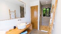clean toilet and bath in Saint Barth Villa Coco Rock luxury holiday home, vacation rental