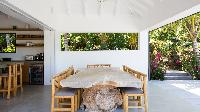 cool dining room of Saint Barth Villa Coco Rock luxury holiday home, vacation rental