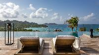 cool poolside deck of Saint Barth Villa Neo luxury holiday home, vacation rental