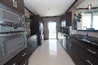 modern kitchen appliances in Costa Rica Ocean View Junior Penthouse luxury apartment