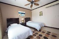 clean and crisp bedroom linens in Costa Rica Ocean View Junior Penthouse luxury apartment