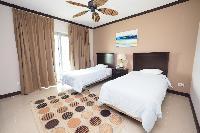 crisp and clean bedroom linens in Costa Rica Ocean View Junior Penthouse luxury apartment