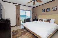 pristine bed sheets and pillows in Costa Rica Ocean View Junior Penthouse luxury apartment