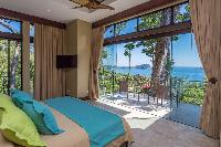 awesome bedroom with a view at Costa Rica Vista Hermosa luxury apartment