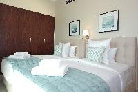 pristine bed sheets and pillows in Dubai Luxury 4 Bedroom Penthouse holiday home