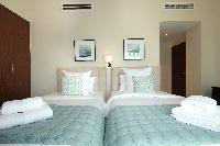pristine pillows and bed sheets in Dubai Luxury 4 Bedroom Penthouse holiday home
