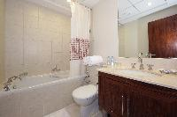 spic-and-span toilet and bath in Dubai Luxury 4 Bedroom Penthouse holiday home