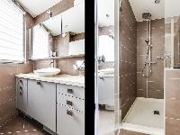 lovely bathroom with a sink and walk-in shower  in a 1-bedroom Paris luxury apartment