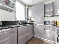 up-to-date open kitchen in a 1-bedroom Paris luxury apartment