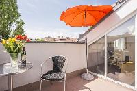 cool deck with fine patio furniture at Vienna - Apartment 1 luxury holiday home and vacation rental
