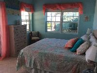 pristine bed sheets in Bahamas - Sand Castle Exuma luxury apartment