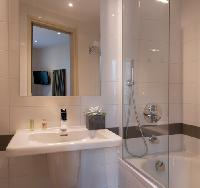 sleek bathroom in a modern 3-star Paris Property for sale near Louvre Museum