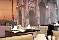 classy restaurant with Arc de Triomphe artwork in Hotel Waldorf Madeleine in Paris