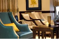 elegant armchairs in elegant rooms of Hotel Waldorf Madeleine in Paris