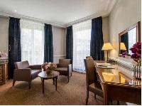 huge floor to ceiling French windows and beautiful cornices in Hotel Waldorf Madeleine in Paris