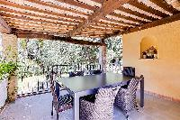 lovely outdoor dining at Cannes - Palm Spring Villa luxury apartment