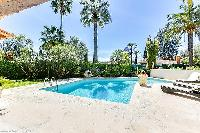 cool swimming pool area of Cannes - Palm Spring Villa luxury apartment
