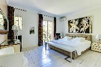 spacious master bedroom of Cannes - Palm Spring Villa luxury apartment