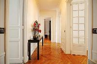 2-bedroom Paris luxury apartment with immaculate white walls, big mirrors and hardwood herringbone f