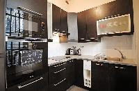 well-equpped kitchen in a 2-bedroom Paris luxury apartment