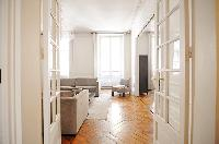 a washer, dryer, and laundry supplies in a 2-bedroom Paris luxury apartment