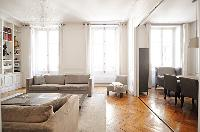 cozy living area and dining area in a 2-bedroom Paris luxury apartment