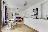 dining and fully functional open kitchen in Paris luxury apartment