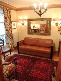 chic living room  with top of the line sleeping couch, a corner table with a gorgeous lamp, and some