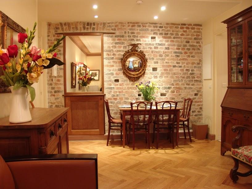 dining area with exposed brick wall, perfectly lined parquet floors, the solid oak or walnut furnitu