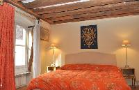 warm and bright master bedroom with two twin beds or a king size bed in a 2-bedroom Triplex Paris ap
