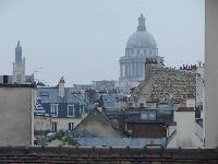 second bedroom with rooftop terrace overlooking the Paris skyline and its picturesque rooftops and t