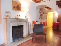 a decorative stone fireplace in a 2-bedroom Triplex Paris apartment