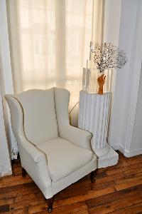 white armchair in Paris luxury apartment