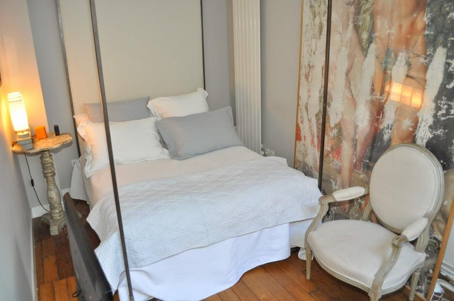 neatly stocked bedroom with a queen size bed in Paris luxury apartment