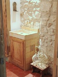 stone-walled sink in Paris luxury apartment