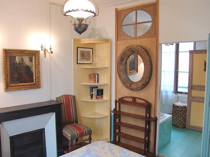 charming 1 bedroom Paris luxury apartment with interior oak shutter, oeil de boeuf oval windows, and